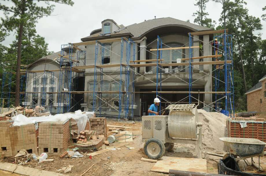 Home construction continues in Woodtrace, a Friendswood Development master-planned community north of Tomball. Photo: Jerry Baker, Freelance