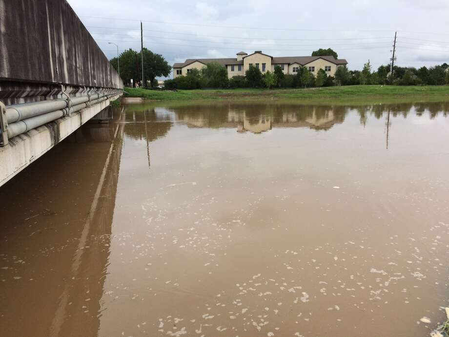 Rain that deluged the area Monday night through Tuesday morning raised water in area streams and creeks, causing fears of flooding. Photo: Craig Moseley / Houston Chronicle