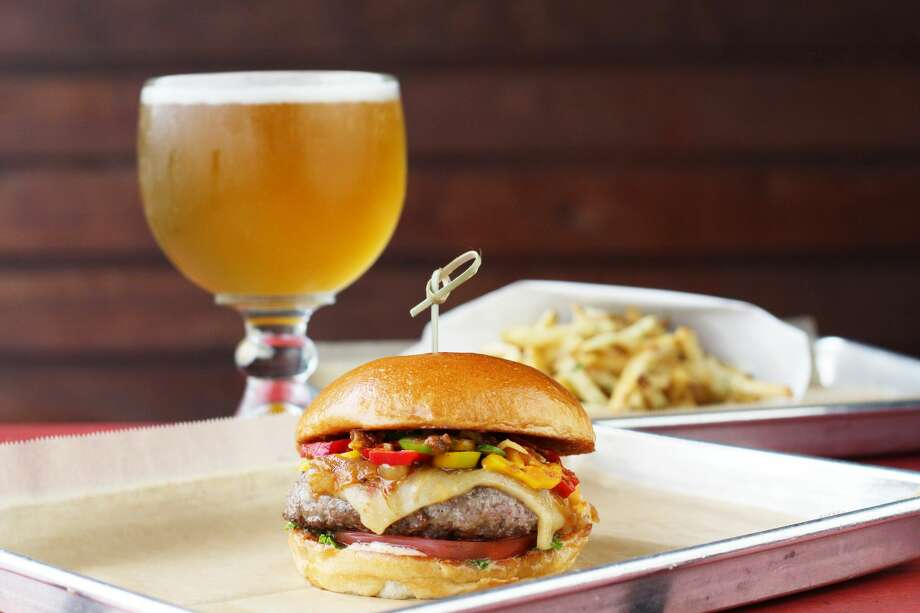 "Hopdoddy will sell the Love at First Sting burger from Aug. 10-22 for $13. Customers will have to sign a waiver before eating the burger, which comes with Trinidad scorpion ""Butch T"" peppers, Bhut jolokia ""ghost peppers,"" serrano peppers, habanero peppers, pepper jack cheese, ghost pepper salsa roja and caramelized onions. Photo: Courtesy, Hopdoddy Burger Bar"