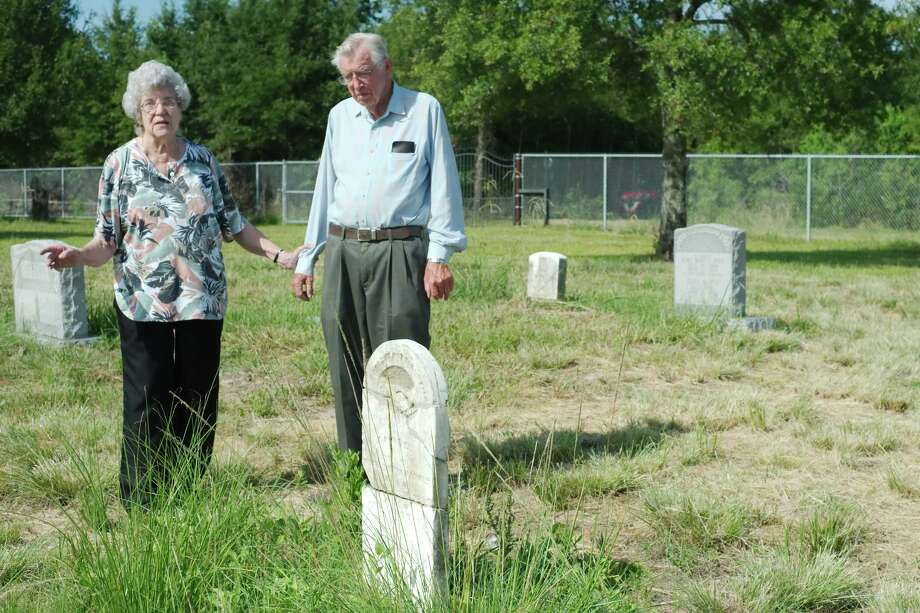 Historian Jean Epperson tells archeology enthusiast Sheldon Kindall stories about Hammer-McFaddin-Harris Cemetery. Harris County Precinct 2 has taken steps to protect the site from feral hogs and improve access to the graves. Photo: Kirk Sides / © 2017 Kirk Sides / Houston Chronicle