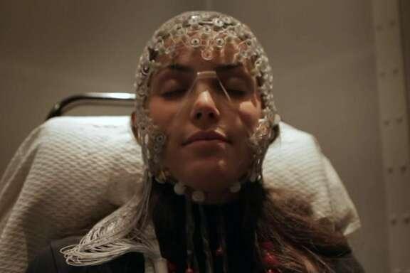 A sleep study participant wearing electroencephalogram sensors.