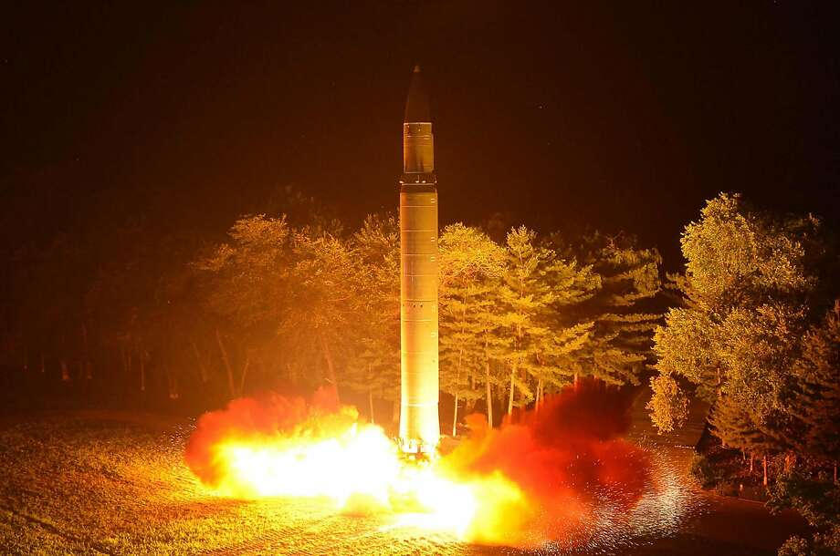 """(FILES) This file photo released from North Korea's official Korean Central News Agency (KCNA) on July 29, 2017 shows North Korea's intercontinental ballistic missile (ICBM), Hwasong-14 being lauched at an undisclosed place in North Korea. North Korea has produced a nuclear warhead small enough to fit inside its missiles, the Washington Post reported on August 8, 2017, a major development sure to further inflame tensions. The Post cited parts of an analysis conducted by the Defense Intelligence Agency that says the intelligence community thinks North Korea has """"nuclear weapons for ballistic missile delivery"""" -- including in intercontinental ballistic missiles.  The Post said the assessment's broad conclusions were verified by two US officials familiar with the analysis.  / AFP PHOTO / KCNA VIS KNS / STR /  - South Korea OUT / REPUBLIC OF KOREA OUT   ---EDITORS NOTE--- RESTRICTED TO EDITORIAL USE - MANDATORY CREDIT """"AFP PHOTO/KCNA VIA KNS"""" - NO MARKETING NO ADVERTISING CAMPAIGNS - DISTRIBUTED AS A SERVICE TO CLIENTS THIS PICTURE WAS MADE AVAILABLE BY A THIRD PARTY. AFP CAN NOT INDEPENDENTLY VERIFY THE AUTHENTICITY, LOCATION, DATE AND CONTENT OF THIS IMAGE. THIS PHOTO IS DISTRIBUTED EXACTLY AS RECEIVED BY AFP.  / STR/AFP/Getty Images Photo: STR, AFP/Getty Images"""