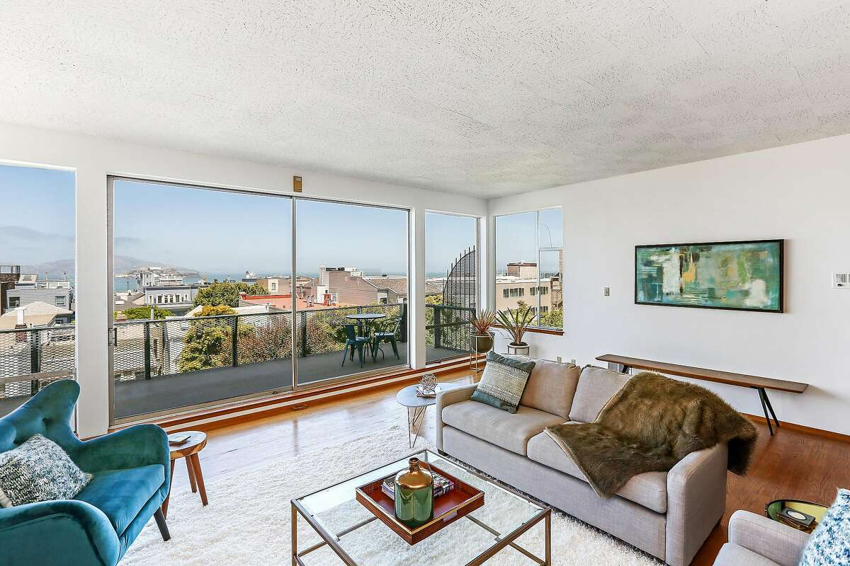 The living area enjoys bay views and access to a view patio.