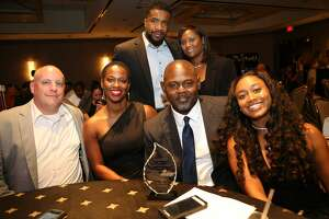 Seated l-r: Larry Hook, Sylvia Williams, 2017 Houston Humanitarian honoree James Williams, Zhanique Williams. In back: Lawrence Thomas and Teresa Yancy at the Third Annual Houston Humanitarian Awards at the Royal Sonesta Hotel.