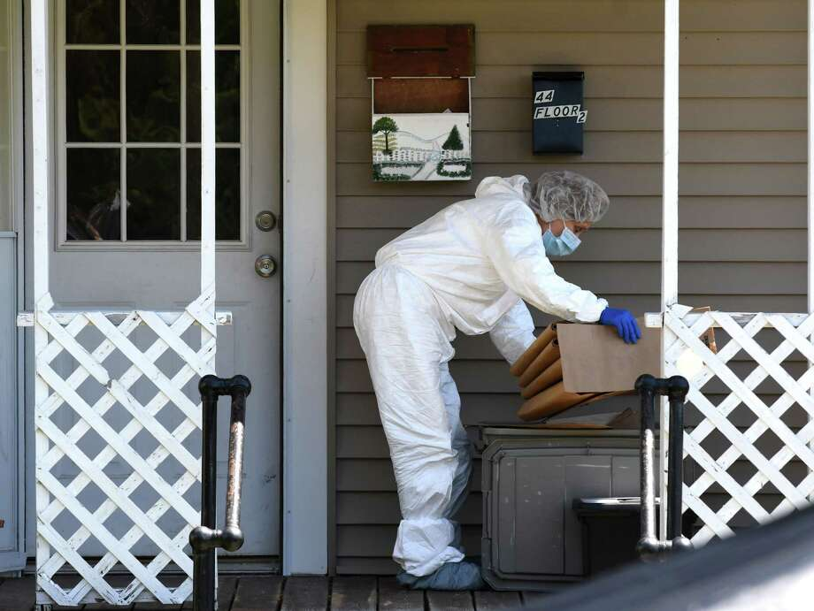 A State Police evidence technician works the crime scene at 44 Grove Street where police are investigating the fatal overnight shooting of a man on Tuesday, Aug. 8, 2017, in Mechanicville, N.Y. (Will Waldron/Times Union) Photo: Will Waldron, Albany Times Union / 20041242A