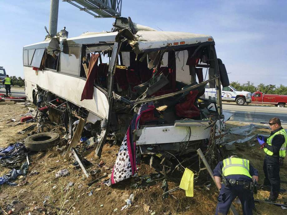 FILE - In this Aug. 2, 2016, file photo, authorities investigate the scene of a charter bus crash on northbound Highway 99 between Atwater and Livingston, Calif. U.S. officials are abandoning plans to require sleep apnea screening for truck drivers and train engineers, a decision that safety experts say puts millions of lives at risk. Photo: Scott Smith /Associated Press / Copyright 2016 The Associated Press. All rights reserved. This material may not be published, broadcast, rewritten or redistribu