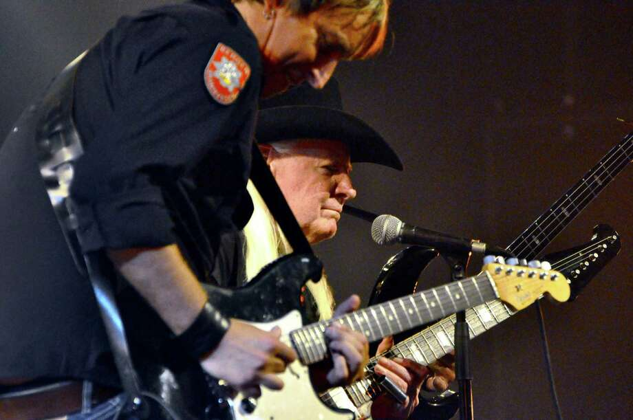 Paul Nelson, left in the foreground, is seen playing live with his longtime collaborator, Johnny Winter, the Texas-born blues guitarist and singer. Photo: Contributed Photo / Courtesy Of Bullseye Management / Stamford Advocate Contributed