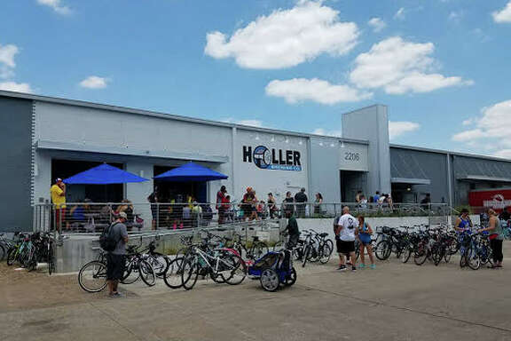Riders finish the ride at Holler Brewing in May 2017.