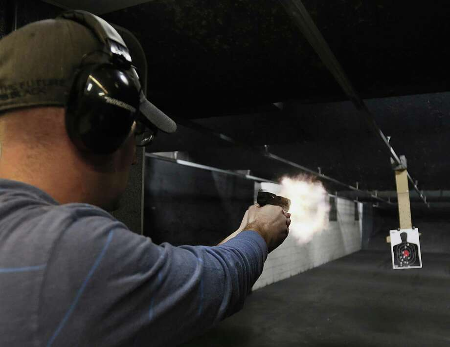 A customer fires a Ruger SR-9 9mm handgun at the Rangemasters of Utah gun range in Springville, Utah. Photo: George Frey / Bloomberg / © 2013 Bloomberg Finance LP