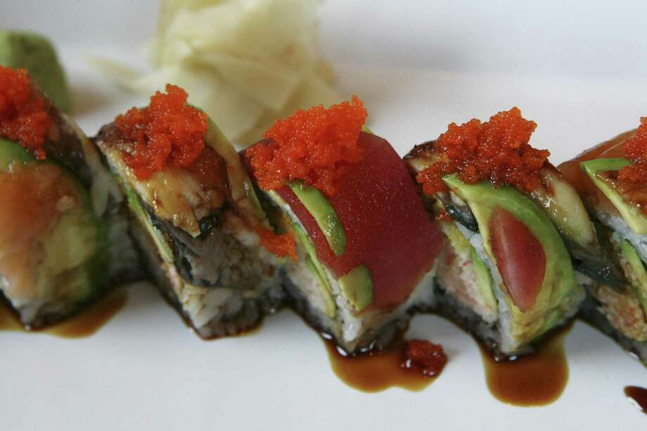 The new Yellowfish Sushi at The Rim will offer the same core menu as the shop's Huebner location, including the C-Roll, with crab salad, avocado, tempura shrimp, tuna, salmon and eel topped with masago. Photo: Express-News File Photo / ©2013 San Antonio Express-News