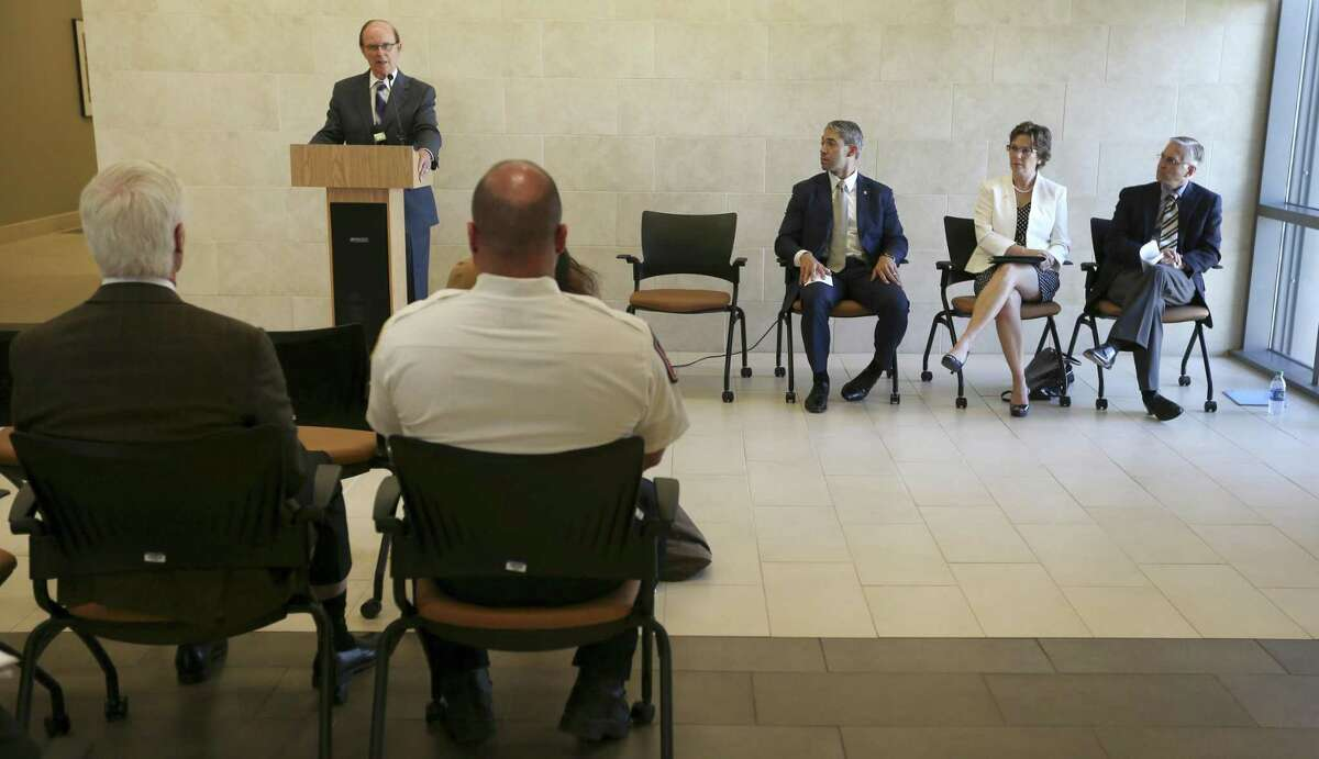 County judge Nelson Wolff speaks Tuesday, Aug. 8, 2017 at the University Health System's Robert B. Green Campus downtown about a recently-formed, county-wide opioid task force formed to try to stay ahead of opioid overdose problems facing other parts of the country. Seated, from left, are San Antonio Mayor Ron Nirenberg, Metropolitan Health District Director Colleen Bridger and University Health System chief medical officer Dr. Bryan Alsip.
