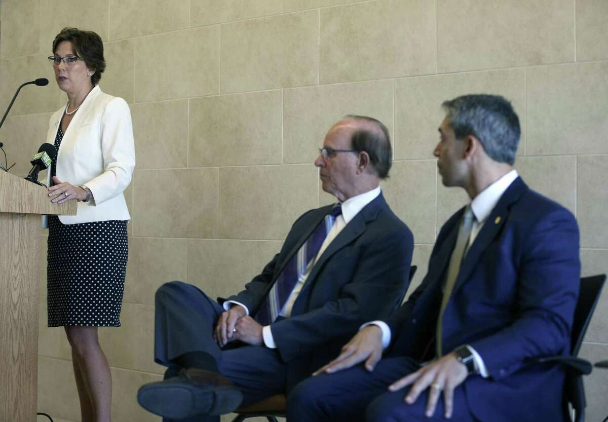 Metropolitan Health District Director Dr. Colleen Bridger speaks Tuesday, Aug. 8, 2017 at the University Health System's Robert B. Green Campus downtown about a recently-formed, county-wide opioid task force formed to try to stay ahead of opioid overdose problems facing other parts of the country. Seated, from left, are county judge Nelson Wolff and San Antonio Mayor Ron Nirenberg.
