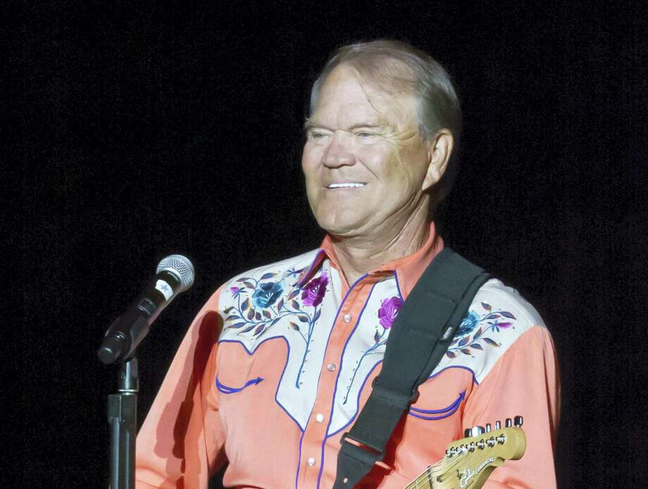 "This Sept. 6, 2012 file photo shows singer Glen Campbell performing during his Goodbye Tour in Little Rock, Ark. Campbell, the grinning, high-pitched entertainer who had such hits as ""Rhinestone Cowboy"" and spanned country, pop, television and movies, died Tuesday, Aug. 8, 2017. He was 81. Campbell announced in June 2011 that he had been diagnosed with Alzheimer's disease. (AP Photo/Danny Johnston, File) Photo: AP Photo/Danny Johnston, File / Copyright 2017 The Associated Press. All rights reserved."