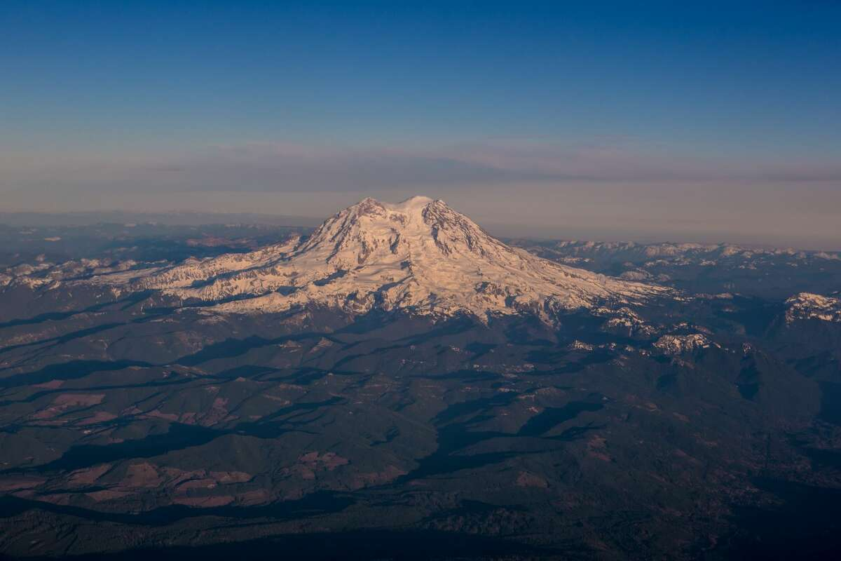 Mount Rainier, a dormant volcano located near Seattle, is viewed on takeoff from Seattle-Tacoma International Airport on November 28, 2013. Though all of the volcanos in the Pacific Northwest are classified as dormant, all pose a threat to large population centers in Washington State and Oregon -- but Mount Rainier's threat is by far the biggest. (Photo by George Rose/Getty Images)