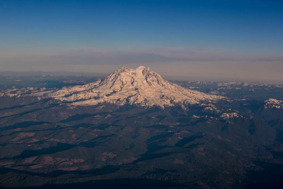 Mount Rainier, a dormant volcano located near Seattle, is viewed on takeoff from Seattle-Tacoma International Airport on November 28, 2013. Though all of the volcanos in the Pacific Northwest are classified as dormant, all pose a threat to large population centers in Washington State and Oregon -- but Mount Rainier's threat is by far the biggest. (Photo by George Rose/Getty Images) Photo: George Rose/Getty Images