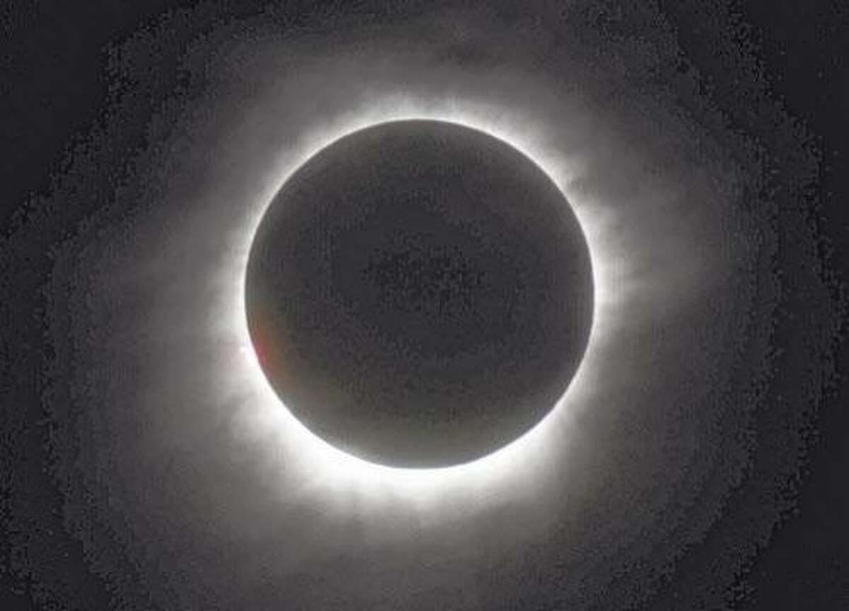 FILE - This March 9, 2016 file photo shows a total solar eclipse in Belitung, Indonesia. Hotel rooms already are going fast in Wyoming and other states along the path of next year's solar eclipse. The total solar eclipse on Aug. 21, 2017, will be the first in the mainland U.S. in almost four decades. (AP Photo, File)