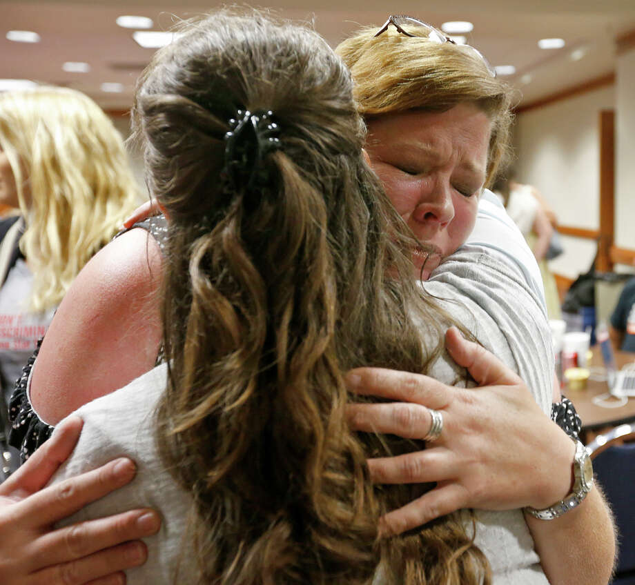 """Minister Kimberly Shappley, left, hugs Michele Pettigrew during a blessing and prayer for transgender Texans, their supporters and in opposition to the """"bathroom bills"""" at the Texas State Capitol. Shappley appears in a PSA issued by the Texas Impact coalition that argues against the SB 3.SLIDESHOW: 10 things to know about the Texas bathroom bill Photo: Edward A. Ornelas, Staff / © 2017 San Antonio Express-News"""