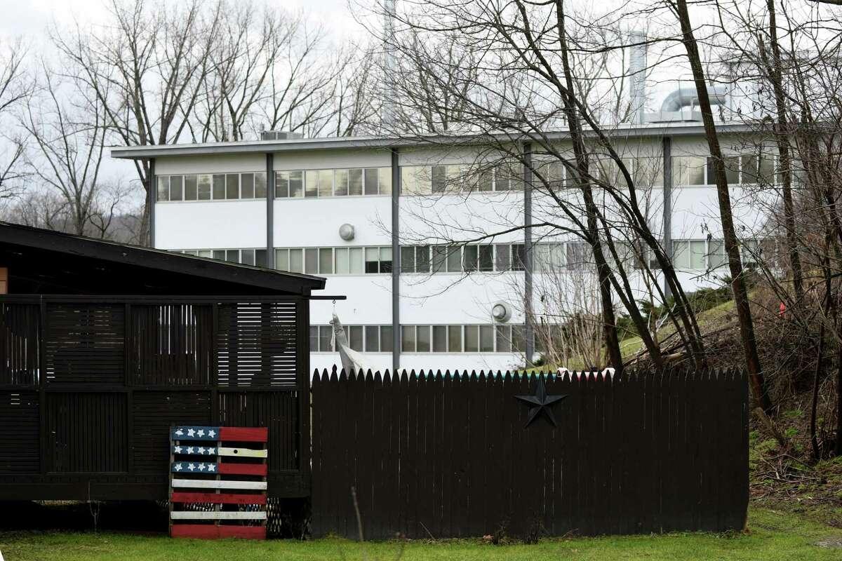 Saint-Gobain Performance Plastics is viewed through a backyard fence on Wednesday, Jan. 4, 2017, in Hoosick Falls, N.Y. (Will Waldron/Times Union)