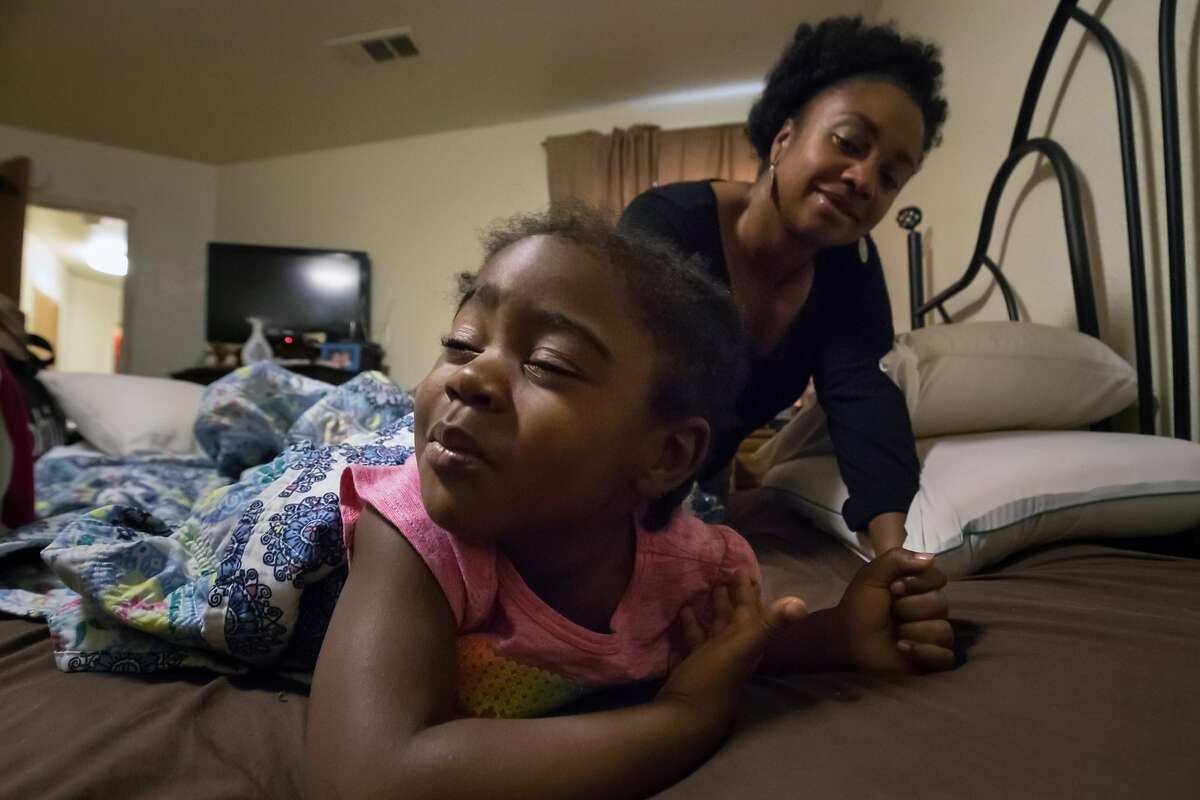 Hope Williams wakes up daughter Kyndahl, 2, on Tuesday, Aug. 8, 2017 in San Francisco, Calif. Williams is part of an advisory group looking at prematurity and the lack sleep.
