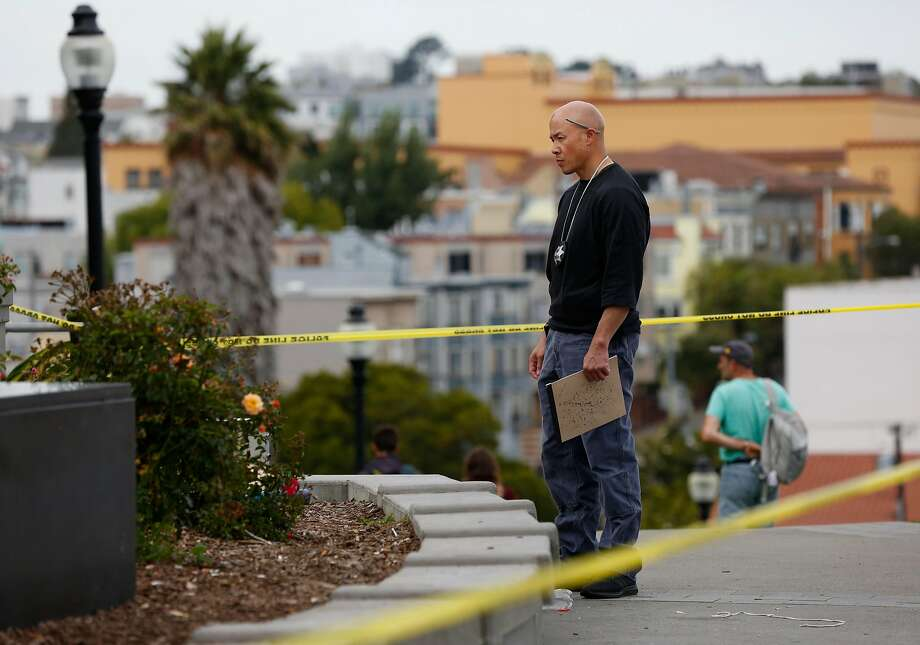 A law enforcement officer investigates an area near the scene of a shooting involving multiple people at Mission Dolores Park August 3, 2017 in San Francisco, Calif. Photo: Leah Millis, The Chronicle