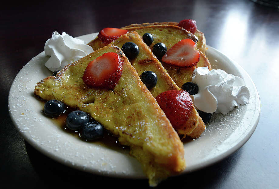 French toast served with colorful seasonal berries, whipped cream and a dusting of powdered sugar is among the popular dining options at the recently opened Kimmy's Cafe in Port Arthur. Photo taken Thursday, August 3, 2017 Kim Brent/The Enterprise Photo: Kim Brent / BEN