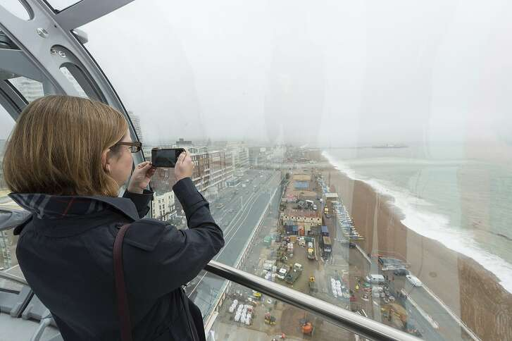 BRIGHTON, UNITED KINGDOM - AUGUST 02:  Guests are seen inside the British Airways i360 observation pod on August 02, 2016 in Brighton, United Kingdom. The viewing pod can hold up to 200 people at a time up to 26 miles of the Sussex coastline can be seen by visitors. The inspiration for the i360 came from the architects, husband and wife team, David Marks and Julia Barfield, who famously originated and designed the London Eye.  (Photo by Ray Tang/Anadolu Agency/Getty Images)