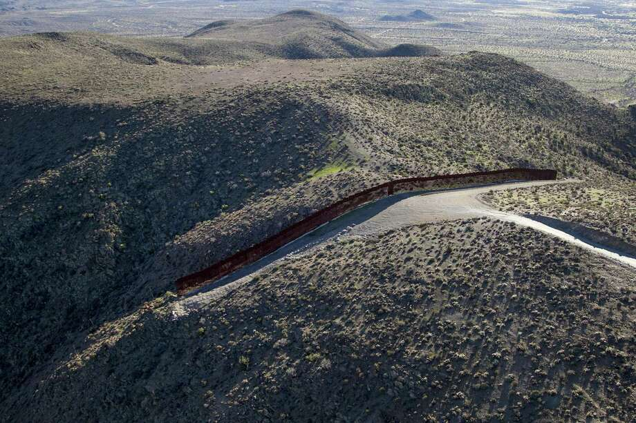 Between Jacumba and Tecate in California, terrain seems to dictate where the current border fence is located. If a wall is going to be built, perhaps there are better technological solutions. Photo: John Gibbins /TNS / San Diego Union-Tribune