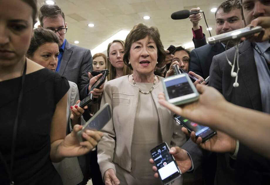 """Sen. Susan Collins, R-Maine is surrounded by reporters as she arrives on Capitol Hill in before a vote on the Republican health care bill. A reader commends the senator for her """"no"""" vote and hopes the failure to pass the law leads to more bipartanship in Congress. Photo: J. Scott Applewhite /Associated Press / Copyright 2017 The Associated Press. All rights reserved."""