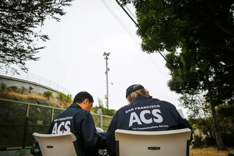 In this file photo, Auxillery Communication Service (ACS) Chief Lawrence Lin and volunteer Peter McElmury get ready for Siren #1 (center) to go off at  22nd and Carolina Streets in San Francisco, Calif., on Tuesday, Aug. 8, 2017. Peter McElmury and Chief of ACS Lawrence Lin take calls from the public who listen to the weekly siren alert system and call in to describe its effectiveness. Photo: Gabrielle Lurie, The Chronicle