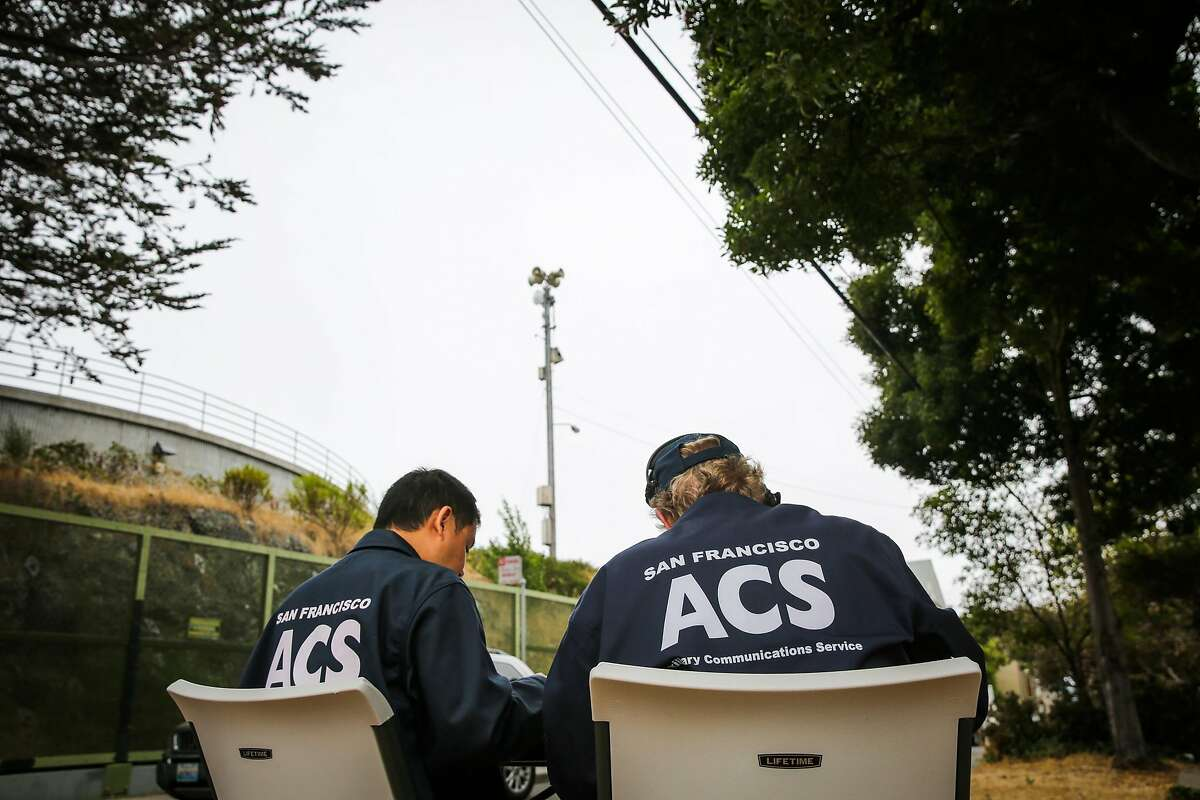 (l-r) Auxillery Communication Service (ACS) Chief Lawrence Lin and volunteer Peter McElmury get ready for Siren #1 (center) to go off at 22nd and Carolina Streets in San Francisco, Calif., on Tuesday, Aug. 8, 2017. Peter McElmury and Chief of ACS Lawrence Lin take calls from the public who listen to the weekly siren alert system and call in to describe its effectiveness.