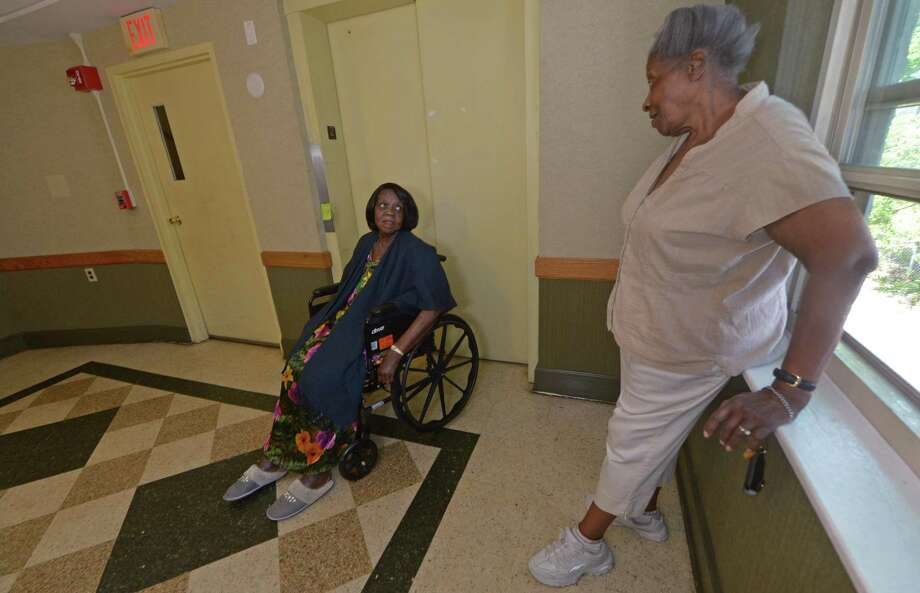 Sally Anderson waits in the second floor hallway near the broken elevator in her building at 20 West Ave. Photo: Erik Trautmann / Hearst Connecticut Media File / Norwalk Hour