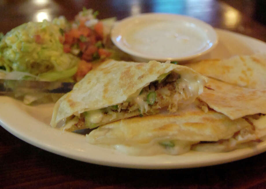 The smoked boudin quesadilla at Tia Juanita's Fish Camp is made with house-made boudin, mozzarella cheese, green onion and is served with guacamole and pico de gallo. Photo: Beth Rankin/cat5