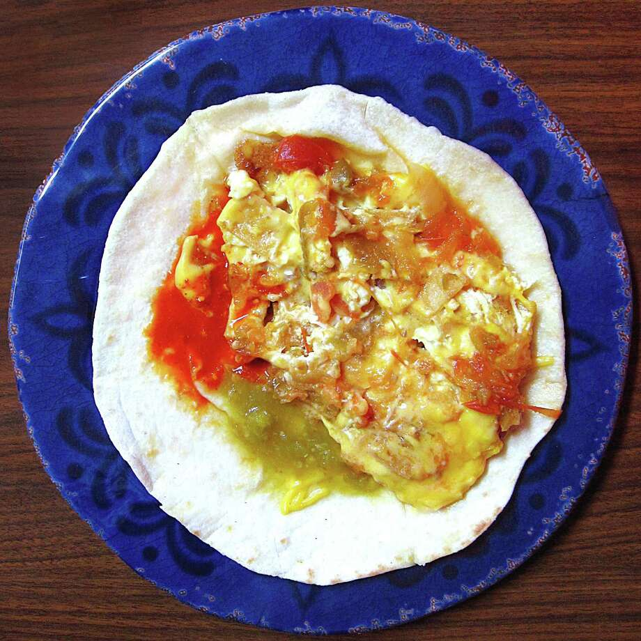 Chilaquiles taco on a handmade flour tortilla from Daniel's Cafe. Photo: Mike Sutter /San Antonio Express-News