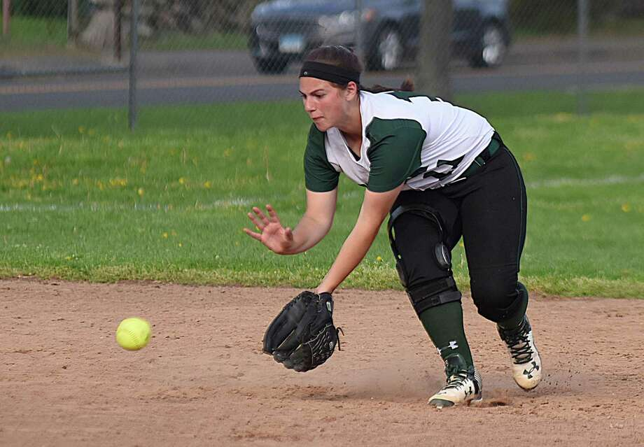 Norwalk shortstop Katie Sciglimpaglia gets ready to scoop up a ground ball during a May 1 FCIAC softball game against New Canaan at Ray Barry Field in Norwalk. New Canaan topped the host Bears 9-5. Photo: John Nash / Hearst Connecticut Media / Norwalk Hour