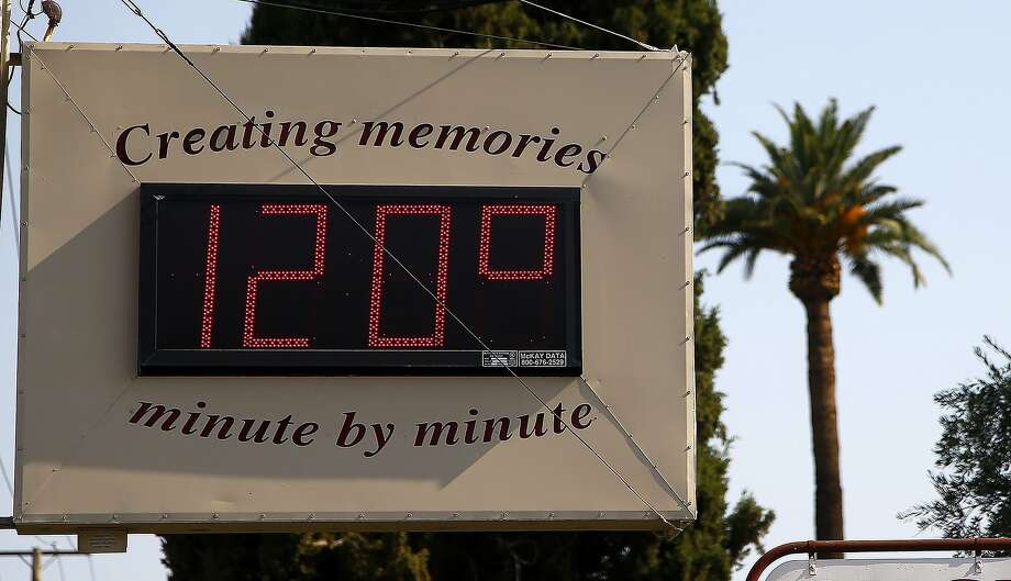 June temperatures reached 120 degrees in Phoenix. Worldwide, 15 of last 16 years have been warmest on record. Photo: Ross D. Franklin, Associated Press