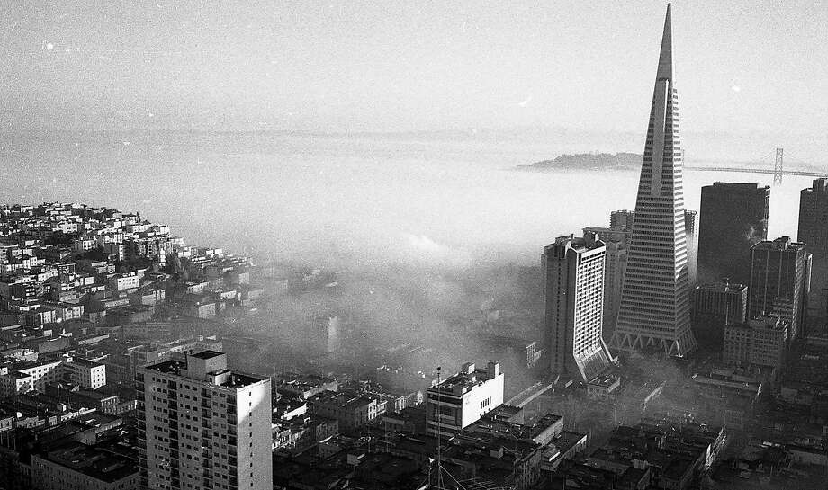 The Transamerica Pyramid and other high-rises appear to be holding the fog back on Feb. 13, 1974. Photo: Dave Randolph, The Chronicle