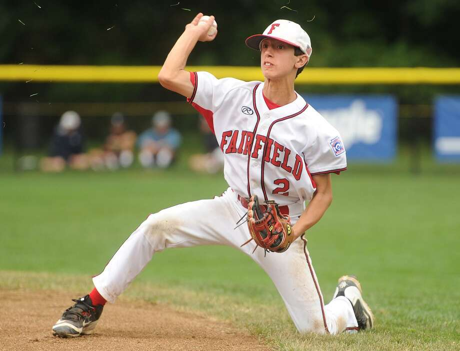 Fairfield American second baseman Matthew Vivona throws from his knees to first base after making a diving stop on a ground ball in the second inning of his team's 8-0 victory over South Portland, Maine in the 2017 Little League Baseball Eastern Regional Tournament in Bristol on Monday, August 7, 2017. Vivona had two home runs and a triple in the game. Photo: Brian A. Pounds / Hearst Connecticut Media / Connecticut Post