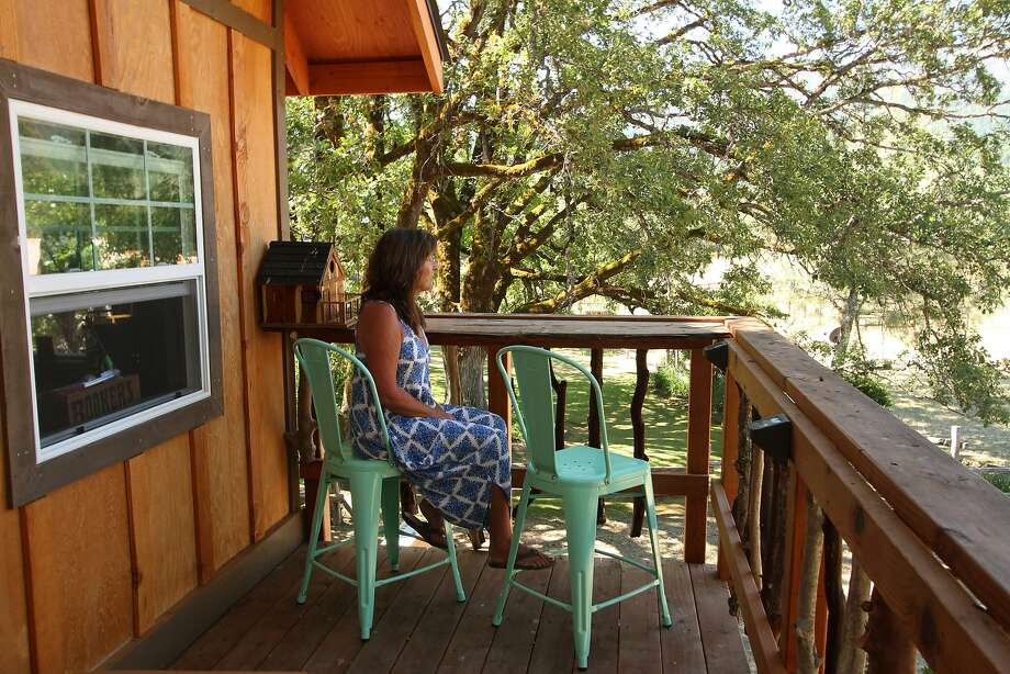 Cory McBride of Santa Cruz at her vacation-home tree house in the Trinity Mountains. Photo: Courtesy Cory McBride