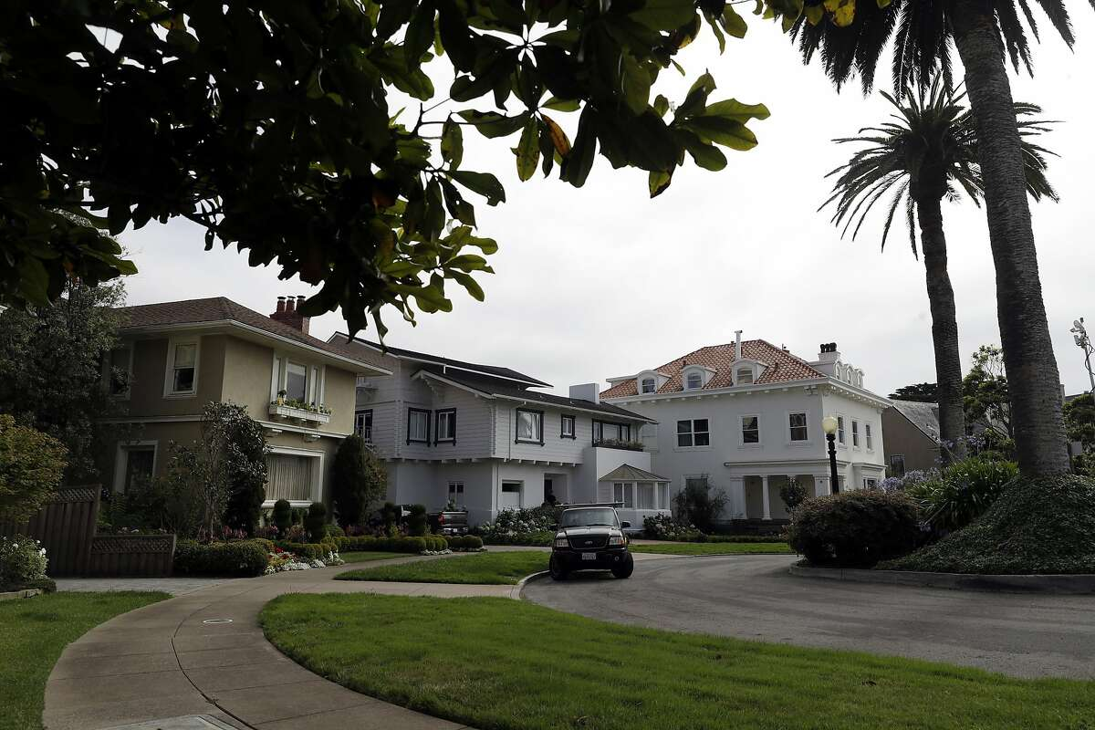 An overview of the Presidio Terrace neighborhood Monday, Aug. 7, 2017, in San Francisco. Thanks to a city auction stemming from an unpaid tax bill, a Bay Area real state investor bought the street in the neighborhood and now owns the sidewalks, the street itself and other areas of