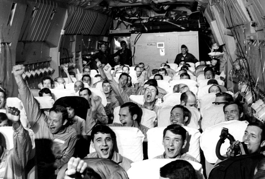 Newly freed prisoners of war celebrate as their C-141a aircraft lifts off from Hanoi, North Vietnam, on Feb. 12, 1973, during Operation Homecoming. The mission included 54 C-141 flights between Feb. 12 and April 4, 1973, returning 591 POWs to American soil. Photo: Courtesy U.S. Air Force