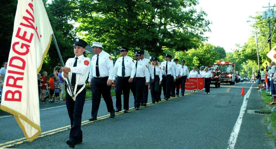 One of the highlights of opening day at the Bridgewater Country Fair is the firemen's parade. Photo: Deborah Rose / Deborah Rose / The News-Times