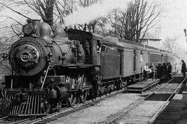 """For years there has been talk of getting passenger rail service up and running in New Milford. It still remains uncertain whether that will happen. But back in 1902, service was active. In this photograph, passengers board the 9:17 southbound train at the Merwinsville Hotel stop in Gaylordsville in New Milford. The man carrying the box is stationmaster Ed Hand. If you have a """"Way Back When"""" photograph you'd like to share, contact Deborah Rose at drose@newstimes.com."""