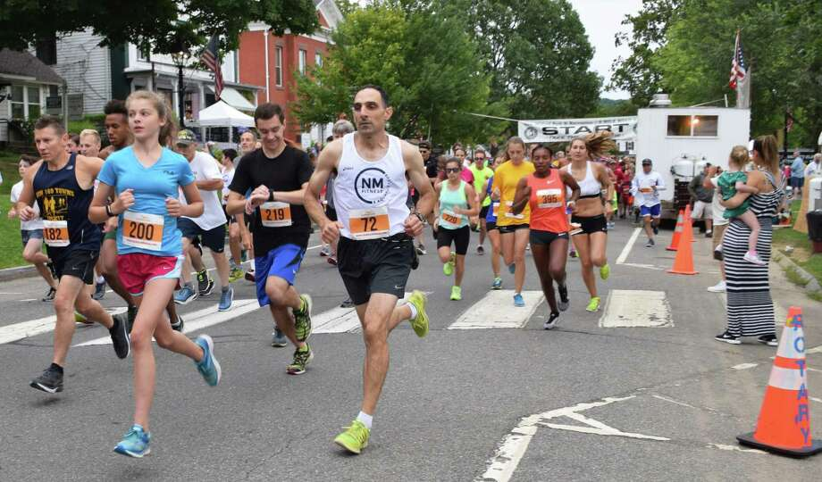 Spectrum/More than 500 people participated in the 50th annual 8-Mile Road Race and 5K during the second day of the Village Fair Days, July 29, 2017. Runners make their way along Main Street at the start of the race. Photo: Deborah Rose / Hearst Connecticut Media / The News-Times  / Spectrum