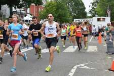 Spectrum/More than 500 people participated in the 50th annual 8-Mile Road Race and 5K during the second day of the Village Fair Days, July 29, 2017. Runners make their way along Main Street at the start of the race.