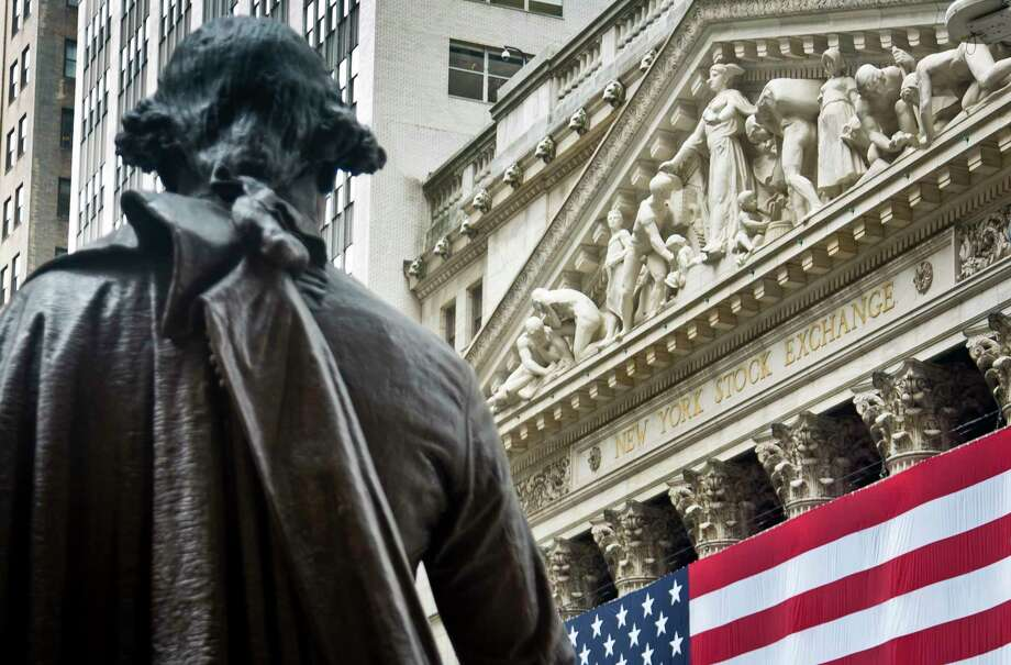 FILE - In this Wednesday, July 8, 2015, file photo, Federal Hall's George Washington statue stands near the flag-covered pillars of the New York Stock Exchange. U.S. stock indexes edged lower in early trading Tuesday, Aug. 8, 2017, pulling back from the market's most recent record highs. Health care and consumer-focused companies were among the biggest laggards. Energy stocks also fell as crude oil prices headed lower. Banks and utilities had some of the biggest gains. (AP Photo/Bebeto Matthews, File) ORG XMIT: NYBZ224 Photo: Bebeto Matthews / Copyright 2017 The Associated Press. All rights reserved.