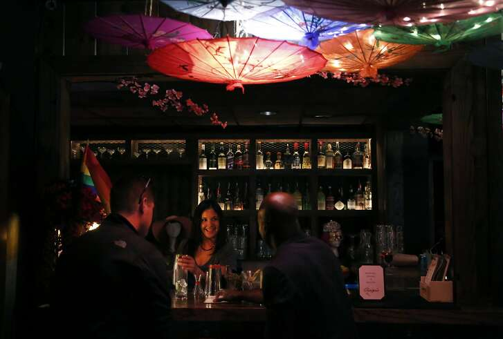 Rachel Valentine mixes a cocktail while chatting with Greg Malman, left, and Reggie Oden at Ginger's in the Financial District August 5, 2017 in San Francisco, Calif.