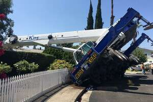 A crane came crashing down on a house in Campbell on Tuesday, police said.