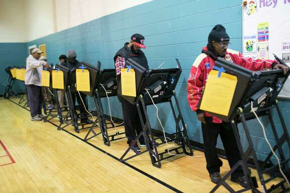 Ohio voters, like these at the Linden Recreation Center in Columbus, may be affected by the state's fight to purge infrequent voters from its election rolls, a desire that the federal government supports.