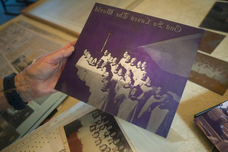 Faye Ebach holds an old photo, one of hundreds of documents she has collected in preparation for the upcoming 150th anniversary of the Episcopal church in Midland. Photo: (Katy Kildee/kkildee@mdn.net)