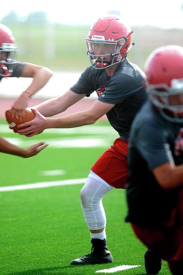 Stanton quarterback Andrew Wheeler practices a hand off Aug. 8, 2017, at Stanton High School. James Durbin/Reporter-Telegram Photo: James Durbin